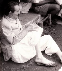 Rare_1950s_Baba_sitting_on_ground_MEHERBABATRAVELS